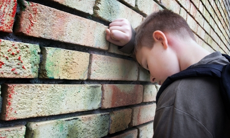 upset boy against a wall Stock Photo - 3768104