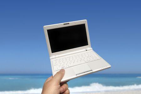 White small Laptop on the beach Stock Photo - 5210578
