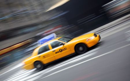 yellow taxi: Motion blur image of yellow Taxi Stock Photo