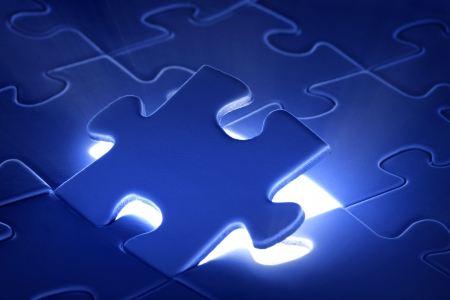 puzzle piece coming down into its place photo