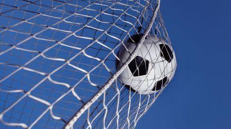 Soccer ball kicked into a goal photo