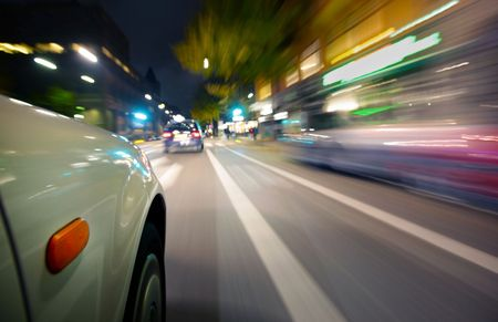 speeding car: Car in motion blur Stock Photo