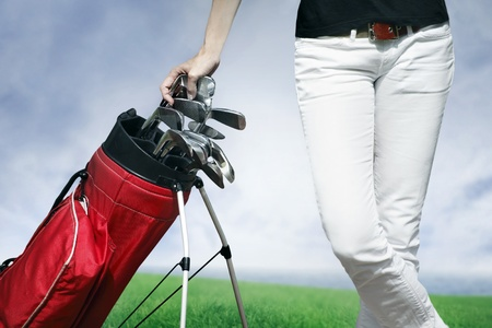 Women standing by golf bag full of sticks 스톡 콘텐츠
