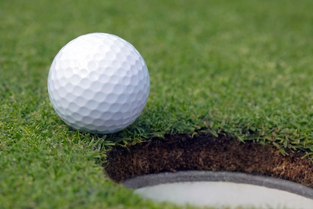 Golfball almost in the hole  photo