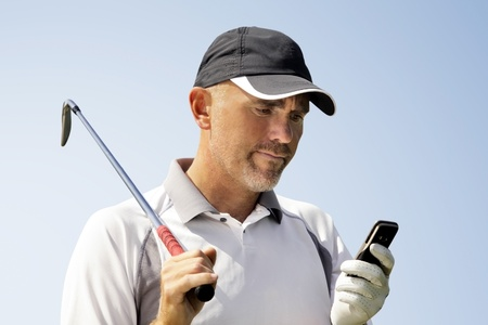 Golfer using mobile phone Stock Photo - 9871241