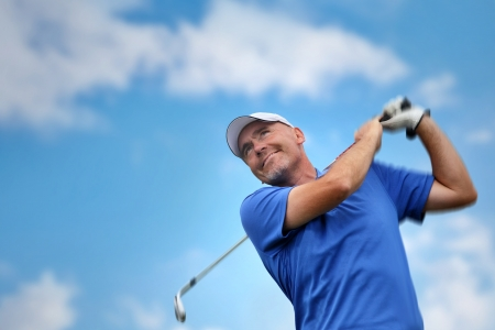 golf swings: golfer shooting a golf ball  Stock Photo