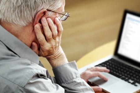 Senior with Laptop, focus on hand  Standard-Bild