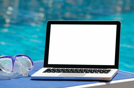 Laptop by swimming pool Stock Photo - 17153866