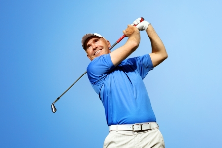 golfer shooting a golf ball  photo