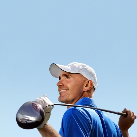 Smiling golfer holding golf club over shoulder