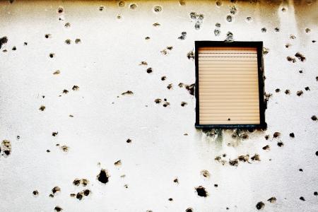 bosnia and hercegovina: Bullet holes in a house facade Stock Photo