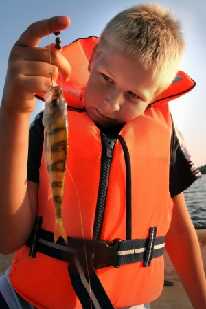 boy holding his catch of the day  photo