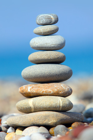 Pile of pebble Stones over blue sky and sea photo