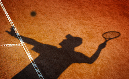 red clay:  Clay tennis court and player concept