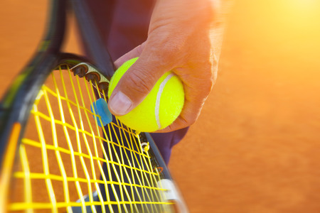 tennis clay:  tennis ball on a tennis court Stock Photo
