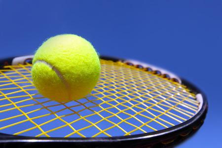 Ball and Racket agains blue sky
