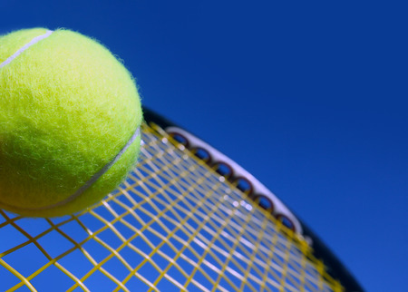 Ball and Racket against  blue sky