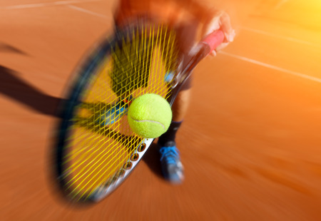male tennis player in action Stockfoto