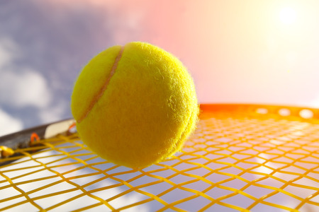 Ball and Racket against  sky