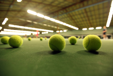 tennis: tennis balls on a tennis court Stock Photo
