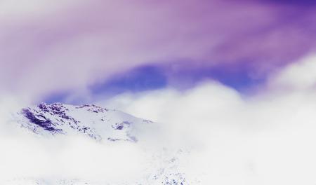 immersed: Alpine peak immersed in clouds of storm