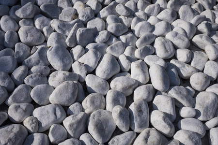 Detail of small gray stones for ormanento of gardens that are part of a path