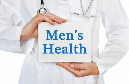 Mens Health card in hands of Medical Doctor Stock Photo