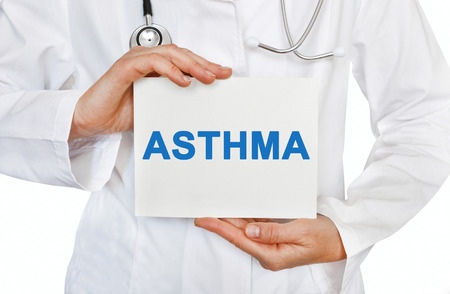 Asthma card in hands of Medical Doctor
