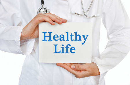 dietology: Healthy Life card in hands of Medical Doctor Stock Photo