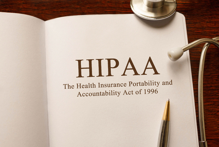 Page with HIPAA The Health Insurance Portability and Accountability Act of 1996 on the table with stethoscope, medical concept