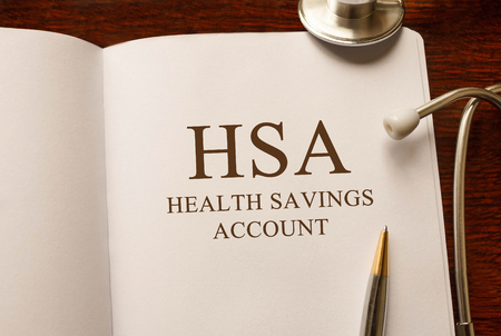 Page with HSA Health Savings Account on the table with stethoscope, medical concept