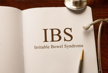 Page with IBS Irritable Bowel Syndrome on the table with stethoscope, medical concept