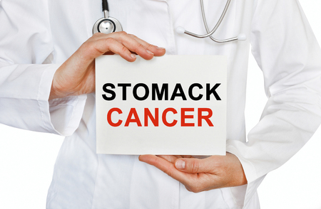 inflammatory bowel diseases: Stomack cancer card in hands of Medical Doctor