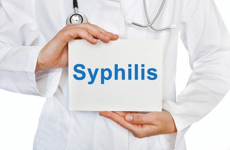 syphilis: Syphilis card in hands of Medical Doctor Stock Photo