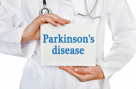 parkinson's disease: Parkinsons disease card in hands of Medical Doctor Stock Photo