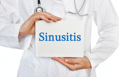 sinusitis: Sinusitis card in hands of Medical Doctor