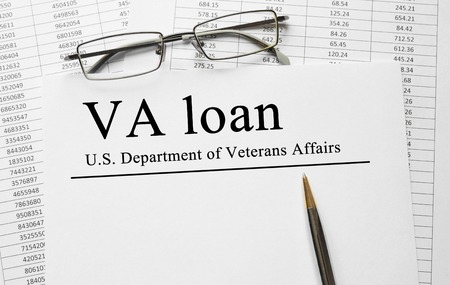 va: Paper with VA loan on a table Stock Photo