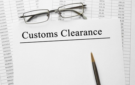 Paper with Customs Clearance on a table Stockfoto