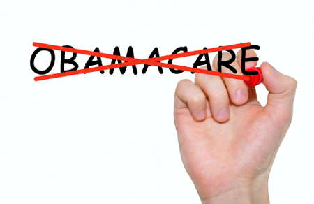 cancellation: Hand writing inscription Obamacare with marker, concept Stock Photo