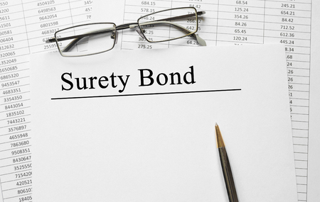 Paper with Surety Bond on a table Stock Photo