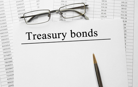 Paper with Treasury bonds on a table Stock Photo