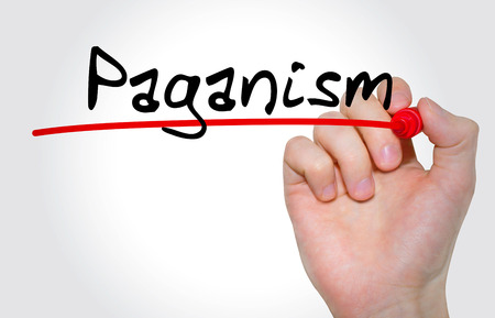 atheism: Hand writing inscription Paganism with marker, concept Stock Photo