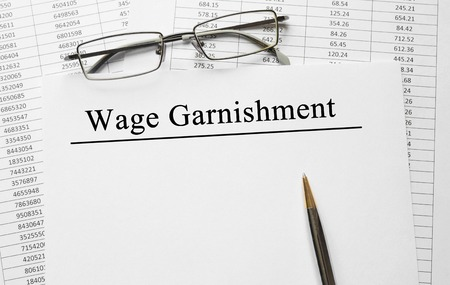 Paper with Wage Garnishment on a table