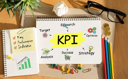 kpi: Notebook with Toolls and Notes about KPI,concept Stock Photo