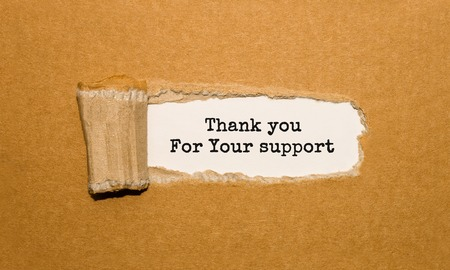 The text Thank you For Your support appearing behind torn brown paper Stockfoto