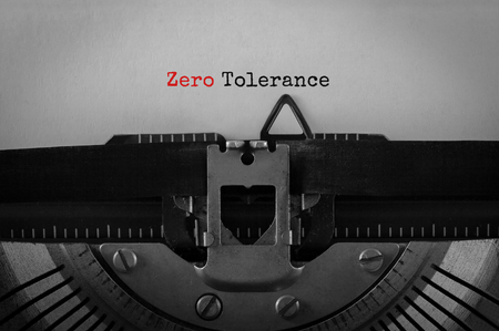 indulgence: Text Zero Tolerance typed on retro typewriter