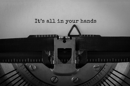 Text It s all in your hands typed on retro typewriter