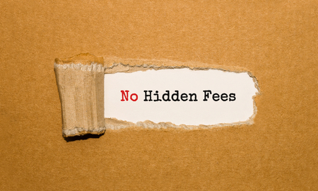 The text No Hidden Fees appearing behind torn brown paper Stock Photo