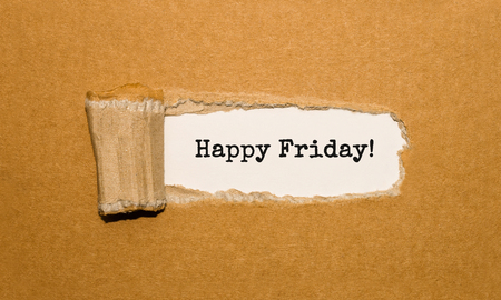 The text Happy Friday appearing behind torn brown paper Stock Photo