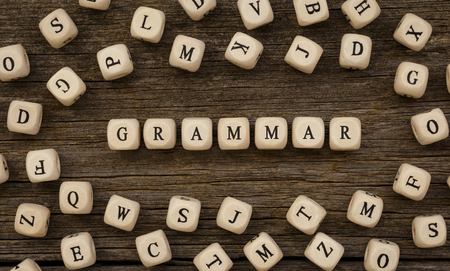 Word GRAMMAR written on wood block